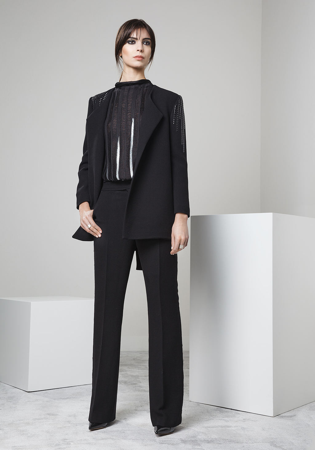 Double crepe jacket with black brillant studs - Knitted merinos wool and silver painted back tshirt - Double crepe bell bottoms trousers